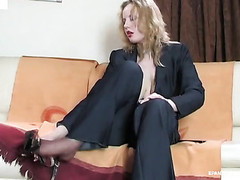 Sexual business woman playing with her tan pantyhose previous to taking 'em on