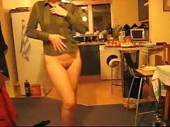 Aged housewife dancing with no panties in the kitchen at xmas.
