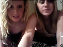 A couple of cute college coeds doing some webcam from a hotel room.  They hide behind a blanket for awhile, but begin showing their gorgeous tits.  Then they stand up and lower their bikini bottoms to flash their pussies.