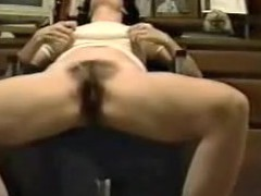 This is a great movie of a woman finger fucking herself at the office. The camera is sitting on the ground looking up at the angel sitting in a chair. You can hear her groaning when that babe makes herself cum.