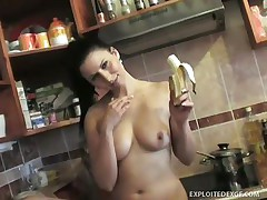 This milf is in her kitchen and that babe want to have some fun. That babe takes off her shirt showing small but good to take up with the tongue tits. That babe take a banana and begin play with it and eat. Surely that babe imagine the banana is a big dick because that babe now is rubbing her love button and vagina very slow and nice.