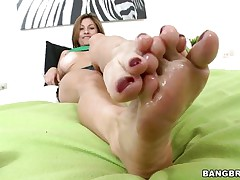 Lisa X is one fine woman from head to toe. Charming Eyes, lovely large tits, lean legs, a nice, round ass, and one yummy-looking pussy! The star this day is her feet, however, and she's getting 'em lubed up to take a knob between 'em and make her stud cum! If she's this good with her feet, then....