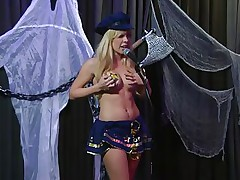 Playboy Radio's Morning Show has some of the hottest honeys you've ever seen! They're talking about Halloween costumes, and their guest has a cop outfit on that looks hot as hell. It gets even sexier when her top comes off, baring her tits. The female host comes over and helps shorten the skirt.