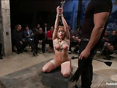 Lea is on her knees, fastened up and fucked in the mouth. The public is watching her with attention and surely they will applaud her, that babe is giving her superlatively good to make the show interesting and that guy inserts his big hard cock unfathomable in her mouth, making her gag a bit. Look at her, will that babe receive a big load?