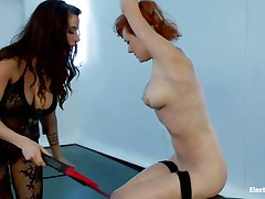 Redhead thrall has her hand tied up over her head and enjoys being punished by her hawt mistress. Her teats get so hard, being pinched by a magic electric wand. As a reward, that playgirl receives her wet crack fingered and becomes so horny, that playgirl wants to cum. The female-dominant prepared more, that playgirl sticks 2 dildos in her holes!