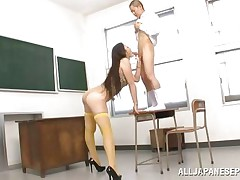 What do you think about this tall slut? Isn't this babe a sexy piece of ass? Her name is Erika and this doxy has a couple of long legs and a nice, firm ass. Erika's cum-hole deserves fingering and licking and her short paramour does the one and the other for her. She's willing to suck his cock, but he has to stand on a desk first.