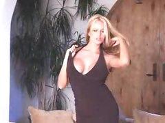 Breasty pornstar in darksome costume striptease